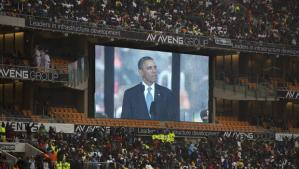 President Obama speaking to attendees of the memorial service Nelson Mandela held in Soweto, 10 December 2013. AP