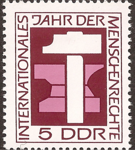 One of a number of East German postage stamps commemorating International Human Rights Year 1968. The hammer and anvil represent the right to work.
