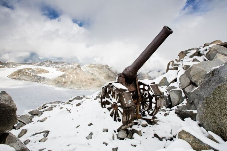 A WW1 Italian cannon sits atop Cresta Croce, a 3,000-meter-high Adamello ridge. Photo by Stefano Torrione, National Geographic Italia