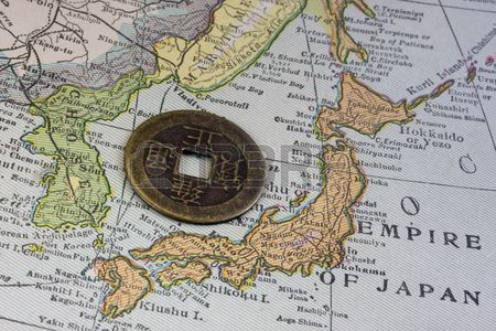 3938923-empire-of-japan-on-a-vintage-map-1926-and-old-japanese-coin-with-square-hole