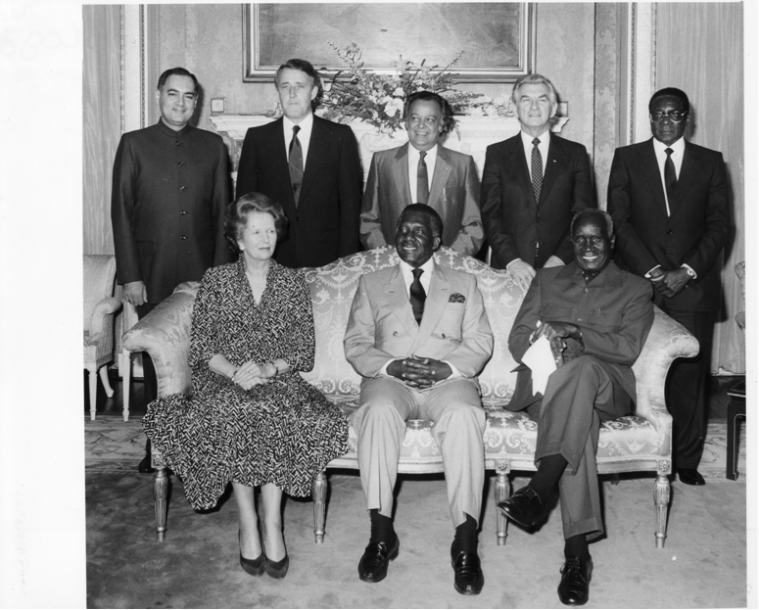 The 1986 Special London Summit of seven Commonwealth Heads of Government to consider further action, including sanctions against South Africa. Pictured: Back row, L to R – Rajiv Gandhi (India) ; Brian Mulroney (Canada); Sonny Ramphal (Commonwealth Secretary-General); Bob Hawke (Australia); Robert Mugabe (Zimbabwe). Front row, L to R: Margaret Thatcher (UK); Lynden Pindling (Bahamas – summit chair); Kenneth Kaunda (Zambia)
