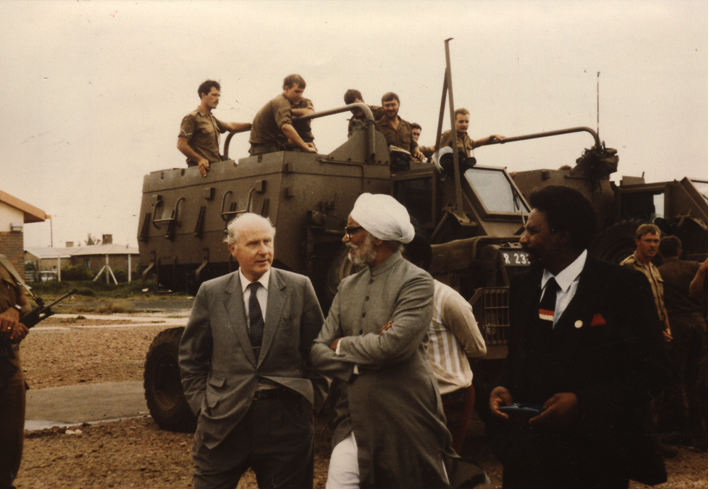 Mission of the Commonwealth Eminent Persons Group to South Africa 1986 Pictured: Lord Tony Barber (UK) and Sardar Swaran Singh (India) among SADF military mounted on casspirs.