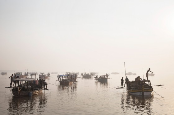 Sand mining boats work illegally on the Thane River near Nagla Bunder Village in Maharashtra, India, March 20, 2013. Photo by Adam Ferguson for WIRED