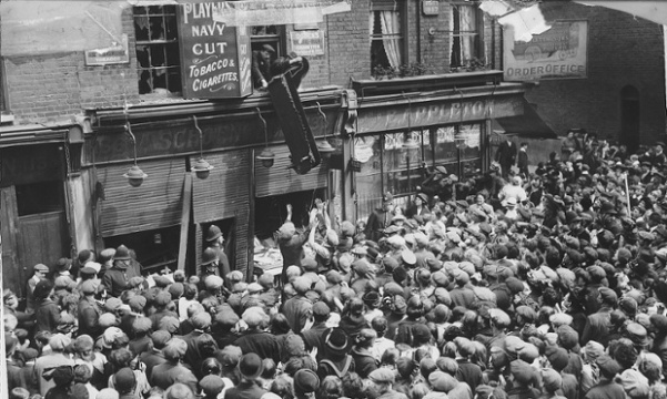 Furniture is thrown from window, Crisp Street, London during an anti-German riot. Photograph: Alamy