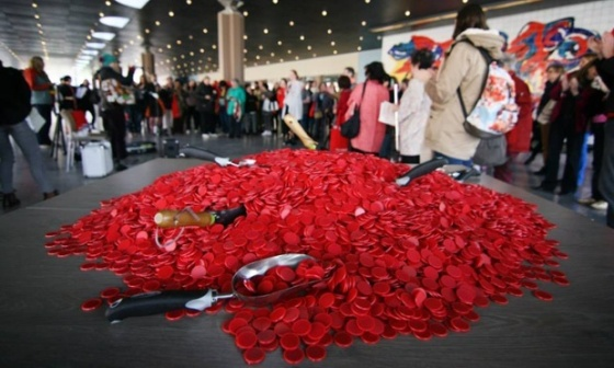 Members of the Women's International League for Peace and Freedom redistribute red poker chips, symbolizing global military spending, as they see fit. Photograph: Mir Grebäck von Melen/WILPF via the Guardian