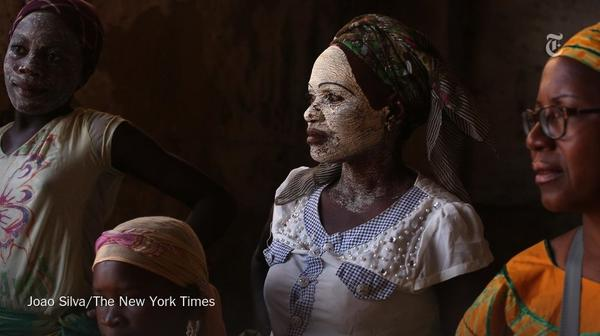 Mozambican women in a building that used to serve as slave housing. Photo: Joao Silva, New York Times.