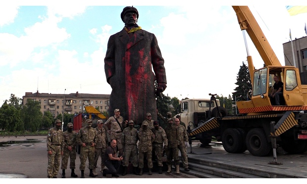 Ukrainian nationalists pose before the statue of Lenin in Sloviansk before tearing it down earlier this month. Photograph: Anadolu Agency/Getty Images