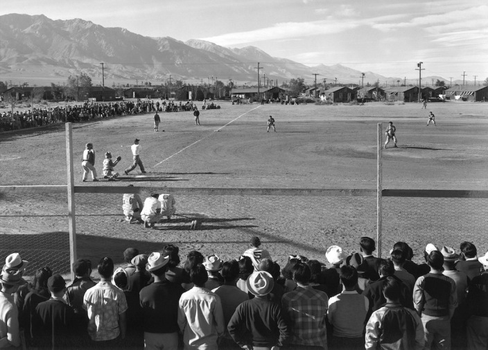 "Japanese Americans play baseball at a WWII internment camp. Ansel Adams, ""Baseball,"" 1943. Courtesy of Photographic Travelling Exhibitions."