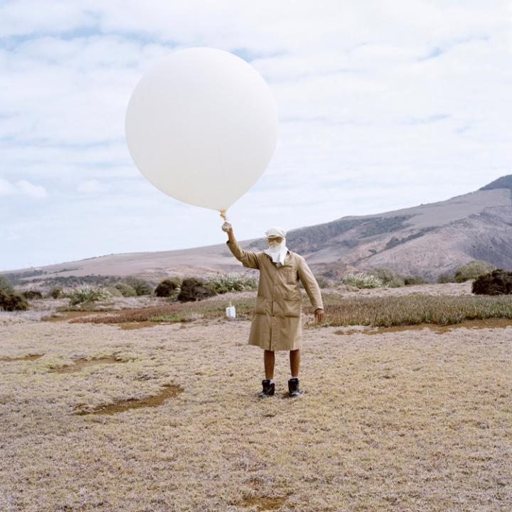 Marcus Henry with his hydrogen filled weather balloon at the Meteorological Station, St Helena CREDIT: JON TONKS