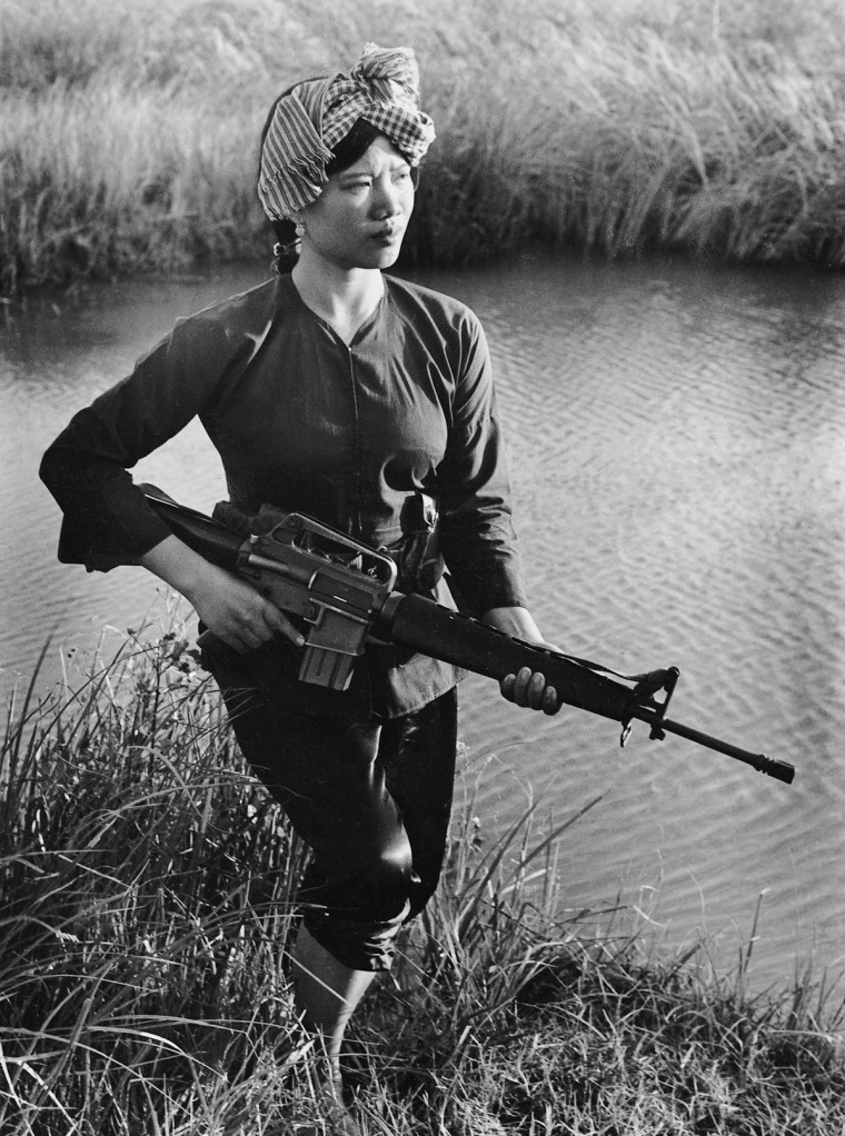 A Viet Cong guerrilla stands guard in the Mekong Delta.  IMAGE: LE MINH TRUONG/ANOTHER VIETNAM/NATIONAL GEOGRAPHIC BOOKS