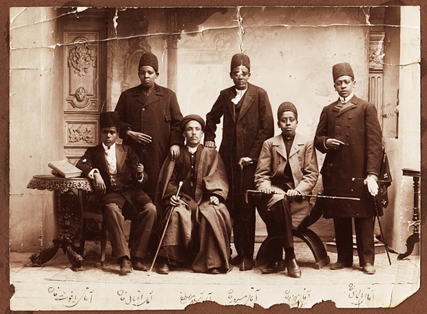 African slaves in Iran during the Qajar era were often eunuchs. Their dress suggests that they belonged to the king or high-ranking members of his court. From right: Aqay-i 'Almas khan, Aqay-i Bahram khan, Aqay-i Masrur, Aqay-i A Seyid Mustafa, Aqay-i Iqbal khan, and Aqay-i Yaqut khan (different person from other photo), 1880s Photograph: Kimia Foundation