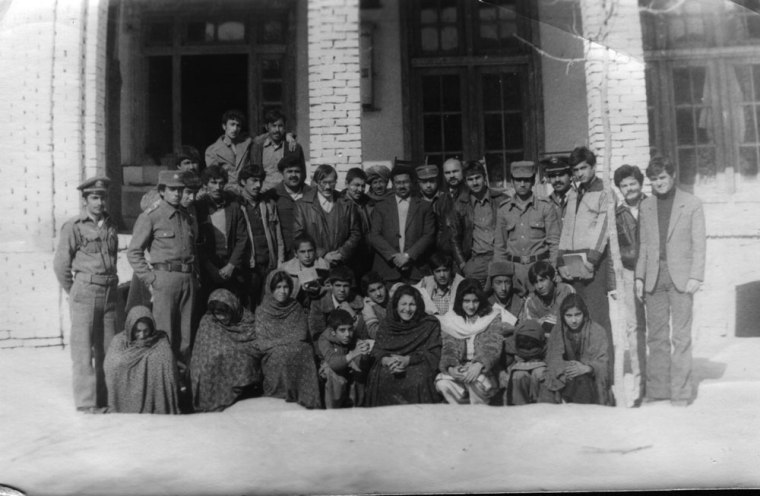 "Soviet advisor Georgii Kireev with Afghan schoolchildren, including unveiled schoolgirls, at a Communist youth event in Kandahar, Afghanistan, mid-1980s. Photograph courtesy of Georgii Kireev, whose ""Kandahar Diary"" I draw on extensively in Humanitarian Invasion."