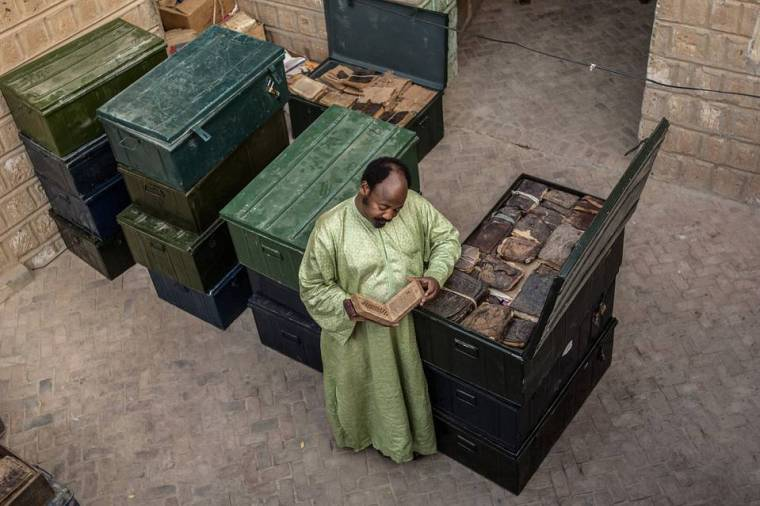 Abdel Kader Haidara with ancient family-owned manuscripts, Timbuktu, Mali, 2007. PHOTO: AMI VITALE/PANOS