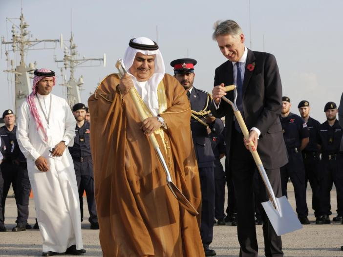 British Foreign Secretary Philip Hammond and Bahraini Foreign Minister Sheik Khalid bin Ahmed Al Khalifa, center help lay a cornerstone for a new British military base being built in Manama, Bahrain. AP Photo/Hasan Jamali